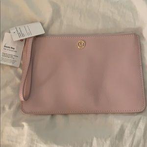 NWT lululemon goody bag (wristlet) in pink